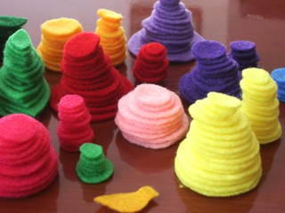 Stacks_of_felt_circles_march